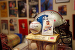 Bob Hope's baseball and trading card signed by Hank Aaron, a baseball player in the Hall of Fame, are marked to sell at $395, Friday, Aug. 23, 2019, in Stone Mountain, Ga.  With a name that made him easy to remember, Hope built a behind-the-scenes career as a hype man, a PR wizard who worked for various sports teams around Atlanta before launching his own firm and setting off on a quixotic, around-the-world quest to make friends and move the needle. (AP Photo/Andrea Smith)