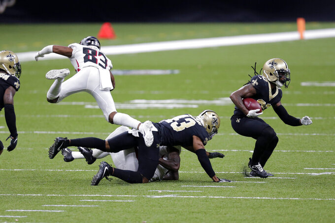 New Orleans Saints cornerback Janoris Jenkins (20) intercepts a pass as Atlanta Falcons wide receiver Russell Gage (83) flies over free safety Marcus Williams (43) in the second half of an NFL football game in New Orleans, Sunday, Nov. 22, 2020. (AP Photo/Brett Duke)
