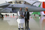 Indian defense Minister Rajnath Singh shakes hands with French Defense Minister Florence Parly at the Dassault Aviation plant in Merignac, near Bordeaux, southwestern France, Tuesday, Oct. 8, 2019. Rajnath Singh formally accepted the first Rafale fighter jet after India had signed a deal with the French government and Dassault Aviation in September 2016, to acquire 36 Rafale fighter jets. (AP Photo/Bob Edme)