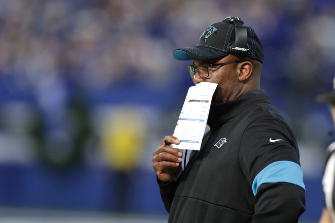 Carolina Panthers interim head coach Perry Fewel watches the first half of an NFL football game against the Indianapolis Colts, Sunday, Dec. 22, 2019, in Indianapolis. (AP Photo/Michael Conroy)