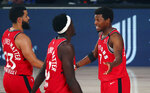 Toronto Raptors guard Kyle Lowry (7) and guard Fred VanVleet (23) and forward Pascal Siakam (43) talk in the first half against the Orlando Magic during the first half of an NBA basketball game Wednesday, Aug. 5, 2020, in Lake Buena Vista, Fla. (Kim Klement/Pool Photo via AP)