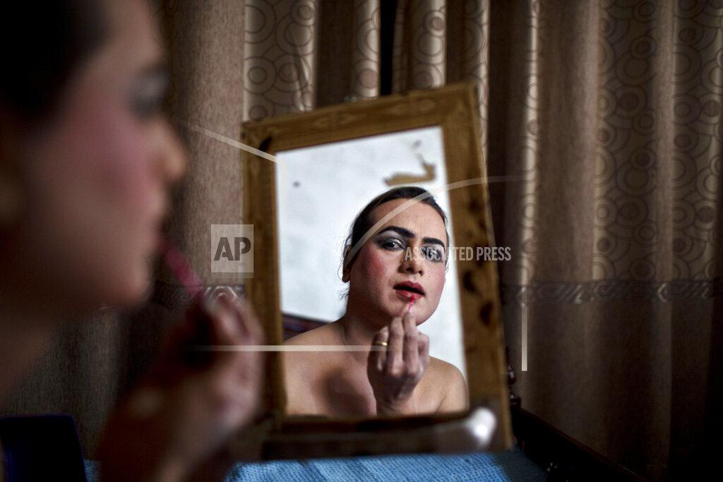 APTOPIX Pakistan Double Life Photo Essay