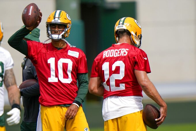 Green Bay Packers' Aaron Rodgers and Jordan Love are seen during NFL football training camp Saturday, Aug. 15, 2020, in Green Bay, Wis. (AP Photo/Morry Gash)