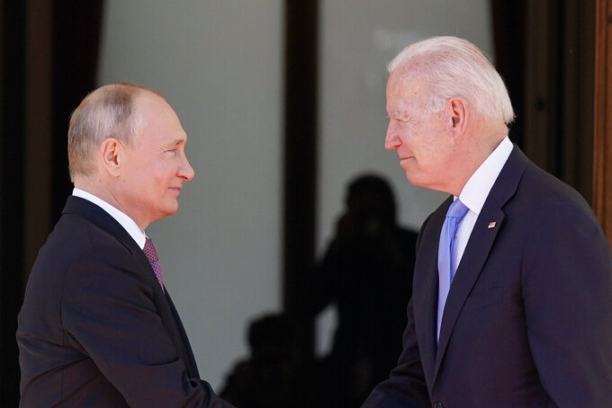 """FILE - In this June 16, 2021 file photo, President Joe Biden and Russian President Vladimir Putin, arrive to meet at the 'Villa la Grange',  in Geneva, Switzerland. In their search for a new approach to arms control, Moscow and Washington are likely to soon encounter an old bugaboo: Russia's demand that the U.S. stop resisting limits on its missile defenses, which the Russians view as a long-term threat and the Americans see as a deterrent to war. It is likely to arise when U.S. and Russian officials open a """"strategic stability"""" dialogue Wednesday in Geneva — talks meant to lay the groundwork for future arms control and to reduce the risk of nuclear war.  (AP Photo/Patrick Semansky)"""