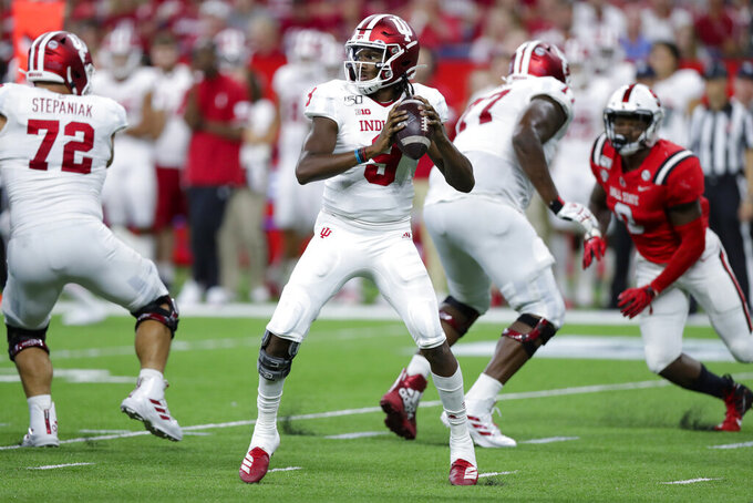 Indiana quarterback Michael Penix Jr. (9) throws against Ball State during the second half of an NCAA college football game in Indianapolis, Saturday, Aug. 31, 2019. Indiana defeated Ball State 34-24. (AP Photo/Michael Conroy)