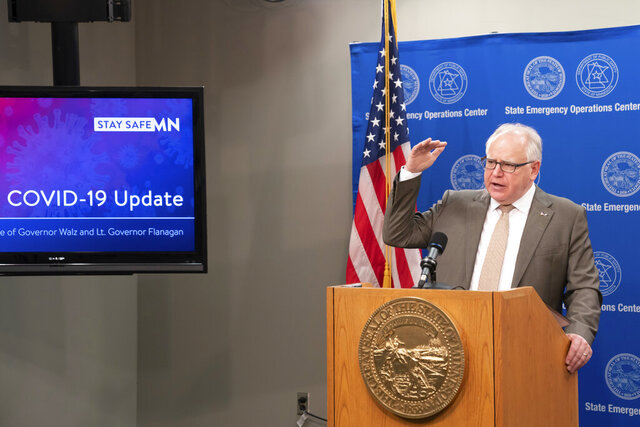 Minnesota Gov. Tim Walz announces new guidelines today for restaurants, bars, salons and barber shops during the coronavirus pandemic Wednesday, May 20, 2020. Restaurants and bars may reopen June 1 for outdoor dining with social distancing and other safeguards in place, while salons and barbershops will also be allowed to resume business at partial capacity. (Glen Stubbe/Star Tribune via AP)