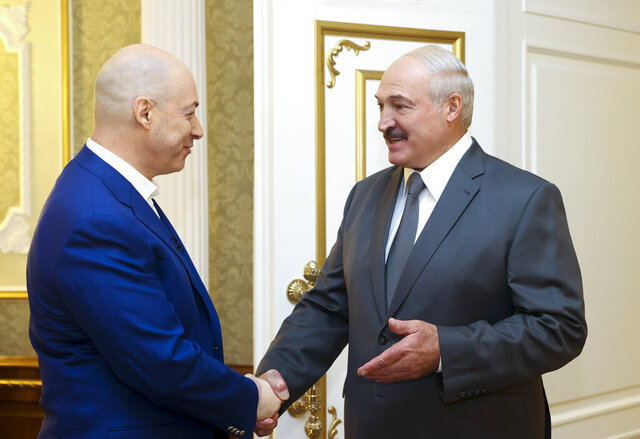 Belarusian President Alexander Lukashenko, right, shakes hand with Ukrainian journalist Dmitro Gordon prior to his interview in Minsk, Belarus, Wednesday, Aug. 5, 2020. (Nikolai Petrov/BelTA, Pool Photo via AP)