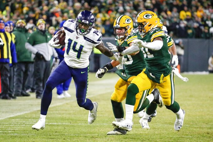 Seattle Seahawks' DK Metcalf runs after a catch during the second half of an NFL divisional playoff football game against the Green Bay Packers Sunday, Jan. 12, 2020, in Green Bay, Wis. (AP Photo/Matt Ludtke)