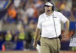 FILE - In this Aug. 24, 2019, file photo, Florida head coach Dan Mullen watches from the sideline during the second half of an NCAA college football game against Miami in Orlando, Fla. This is the time of year when the Southeastern Conference usually validates its claim as the best league in college football by dominating neutral-site nonconference matchups. The SEC is 21-6 in regular-season nonconference games against Power Five opponents at neutral sites since 2012. (AP Photo/Phelan M. Ebenhack, File)