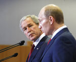 FILE - In this April 6, 2008 file photo, President George Bush, left, and Russian President Vladimir Putin, look on during a press conference at the Russian Presidential residence Bochorov Ruchei, in Sochi, Russia. (AP Photo/Gerald Herbert)
