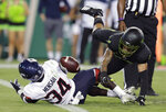 Connecticut running back Kevin Mensah (34) loses the ball in the end zone after a hit by South Florida defensive back Mekhi LaPointe (22) during the first half of an NCAA college football game Saturday, Oct. 20, 2018, in Tampa, Fla. Mensah made a touchdown. (AP Photo/Chris O'Meara)