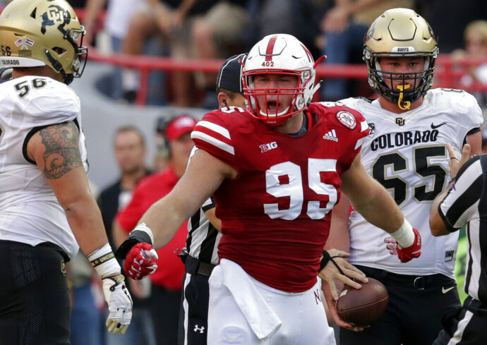 FILE- In this Sept. 8, 2018, file photo, Nebraska defensive lineman Ben Stille (95) celebrates a sack of Colorado quarterback Steven Montez during the second half of an NCAA college football game in Lincoln, Neb. The Nebraska defense is counting on Stille and his linemates as the 24th-ranked Cornhuskers try to rebound from a 4-8 record last year. (AP Photo/Nati Harnik, File)
