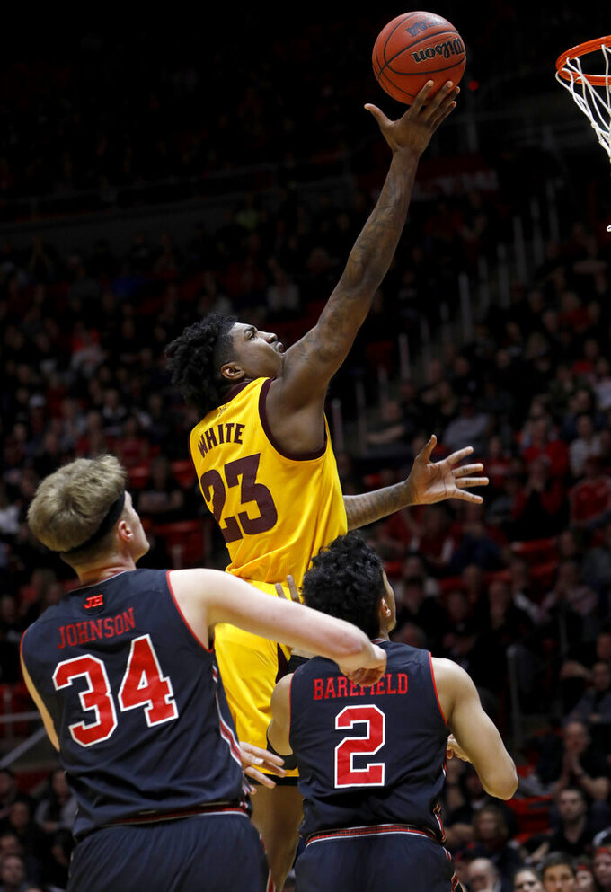 Arizona State's Romello White (23) shoots a layup as Utah's Jayce Johnson (34) and Sedrick Barefield (2) defend during the first half of an NCAA college basketball game Saturday, Feb. 16, 2019, in Salt Lake City. (AP Photo/Kim Raff)