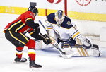 Calgary Flames' Tobias Rieder, left, from Germany, scores a short-handed goal against Buffalo Sabres goaltender Linus Ullmark, from Sweden, during the second period of an NHL hockey game Thursday, Dec. 5, 2019, in Calgary, Alberta. (Larry MacDougal/The Canadian Press via AP)