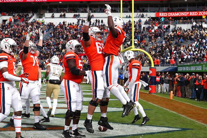 Virginia celebrates a touchdown against Georgia Tech during an NCAA college football game, Saturday, Nov. 9, 2019, in Charlottesville, Va. (Erin Edgerton/The Daily Progress via AP)