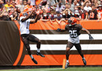 Cleveland Browns wide receiver Donovan Peoples-Jones catches a touchdown pass against cornerback Brian Allen during an Orange and Brown NFL football practice in Cleveland, Sunday, Aug. 8, 2021. (Joshua Gunter/The Plain Dealer via AP)