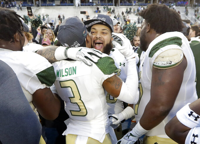 UAB defensive lineman Bentley Easley, center, celebrates with wide receiver Andre Wilson (3) after UAB defeated Middle Tennessee in the Conference USA championship NCAA college football game Saturday, Dec. 1, 2018, in Murfreesboro, Tenn. UAB won 27-25. (AP Photo/Mark Humphrey)