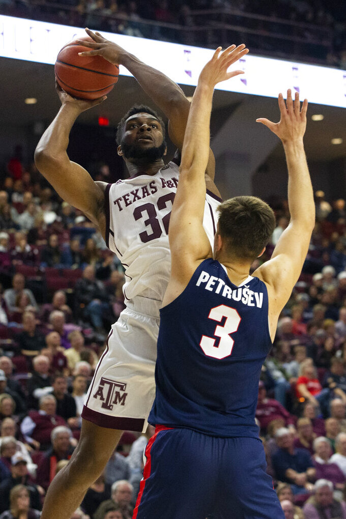 Texas A&M forward Josh Nebo (32) shoots as Gonzaga forward Filip Petrusev (3) defends during the second half of an NCAA college basketball game Friday, Nov. 15, 2019, in College Station, Texas. (AP Photo/Sam Craft)