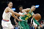 Boston Celtics' Jayson Tatum (0) and Philadelphia 76ers' Landry Shamet (1) can't come up with a loose ball during the first half of an NBA basketball game in Boston, Tuesday, Dec. 25, 2018. (AP Photo/Michael Dwyer)