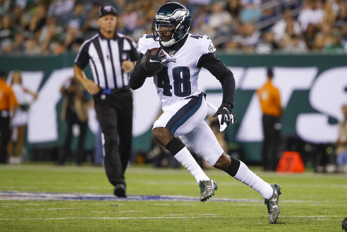 Philadelphia Eagles' Josh Hawkins (48) runs back an interception during the second half of a preseason NFL football game against the New York Jets, Thursday, Aug. 29, 2019, in East Rutherford, N.J. (AP Photo/Matt Rourke)