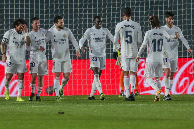 Real Madrid's Ferland Mendy celebrates after scoring his side's second goal during the Spanish La Liga soccer match between Real Madrid and Getafe at Alfredo di Stefano stadium in Madrid, Spain, Tuesday, Feb. 9, 2021. (AP Photo/Bernat Armangue)
