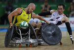 """FILE - In this Sept. 16, 2016, file photo, Australia's Ryley Batt fights for the ball with United States' Chuck Aoki during a mixed wheelchair rugby final match at the Paralympic Games in Rio de Janeiro, Brazil. Batt is among several Paralympic athletes who are profiled in the Nexflix documentary """"Rising Phoenix"""" that will be released in 190 countries on Wednesday, Aug. 26, 2020.(AP Photo/Leo Correa, File)"""