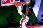 Miami Heat forward Bam Adebayo (13) dunks the ball during the second half of an NBA conference final playoff basketball game against the Boston Celtics on Thursday, Sept. 17, 2020, in Lake Buena Vista, Fla. (AP Photo/Mark J. Terrill)
