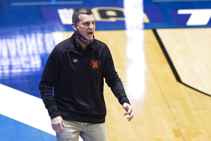 Maryland coach Mark Turgeon yells to players during the first half of a first-round game against Connecticut in the NCAA men's college basketball tournament Saturday, March 20, 2021, at Mackey Arena in West Lafayette, Ind. Maryland won 63-54. (AP Photo/Robert Franklin)