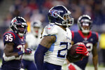 Tennessee Titans running back Derrick Henry (22) runs for a 53-yard touchdown during the second half of an NFL football game Sunday, Dec. 29, 2019, in Houston. The run moved Henry into first place for the season rushing title. The Titans won 35-14. (AP Photo/Michael Wyke)