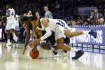 Villanova's Phil Booth, right, and Butler's Kamar Baldwin chase after a loose ball during the second half of an NCAA college basketball game, Saturday, March 2, 2019, in Philadelphia. Villanova won 75-54. (AP Photo/Matt Slocum)