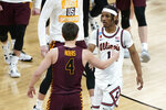 Loyola of Chicago's Braden Norris (4) shakes hands with Illinois' Trent Frazier (1) after a college basketball game in the second round of the NCAA tournament at Bankers Life Fieldhouse in Indianapolis Sunday, March 21, 2021. Loyola upset Illinois 71-58. (AP Photo/Mark Humphrey)