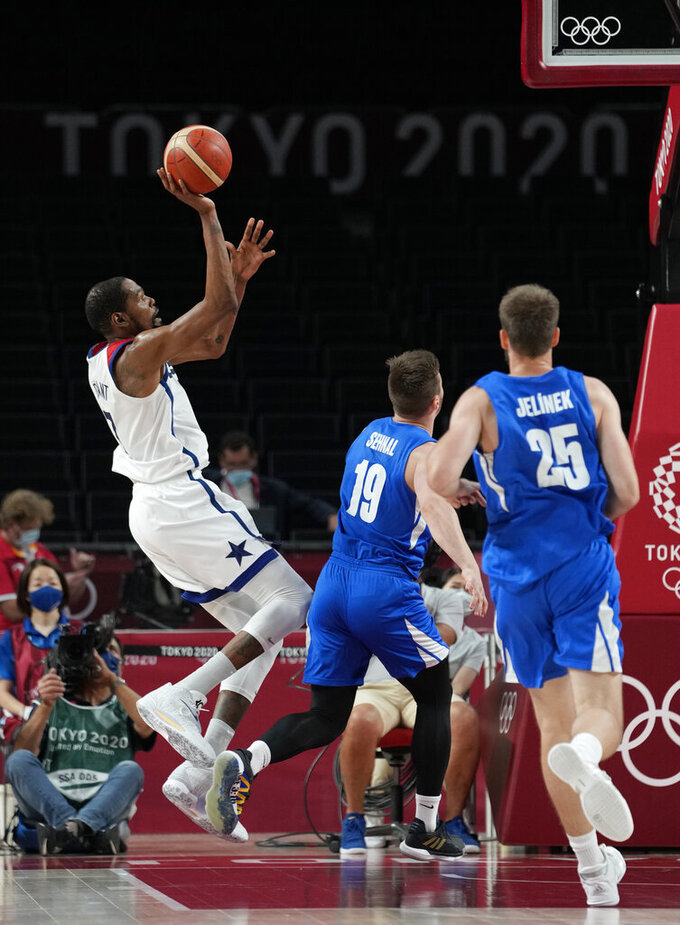 United States's Kevin Durant, left, shoots against the Czech Republic during a men's basketball preliminary round game at the 2020 Summer Olympics, Saturday, July 31, 2021, in Saitama, Japan. (AP Photo/Eric Gay)
