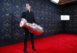 Jordan Binnington of the St. Louis Blues holds the Stanley Cup on the red carpet before the NHL Awards, Wednesday, June 19, 2019, in Las Vegas. (AP Photo/John Locher)