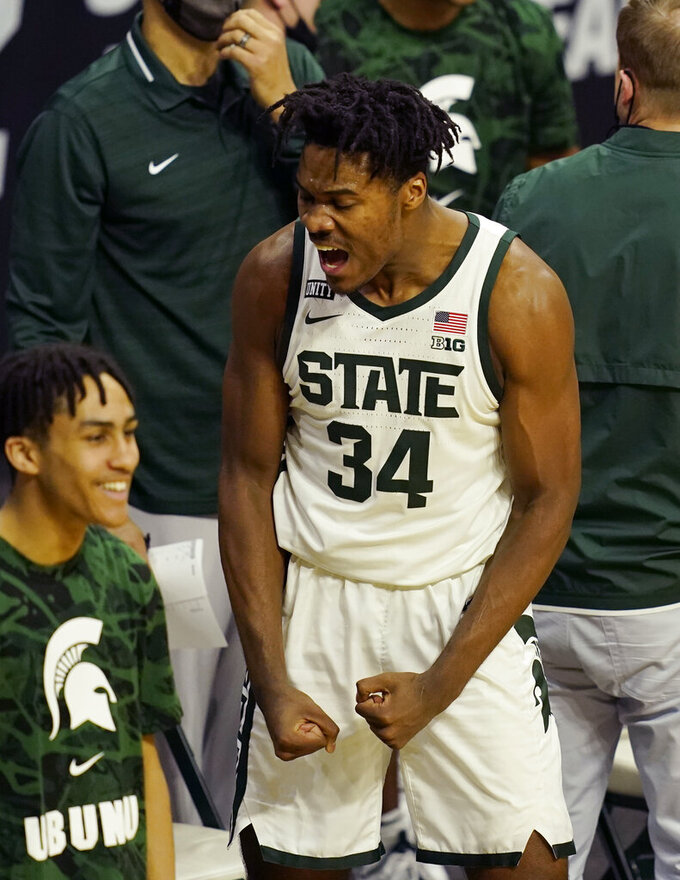 Michigan State forward Julius Marble II reacts after a play from a teammate during the second half of an NCAA college basketball game against Michigan, Sunday, March 7, 2021, in East Lansing, Mich. (AP Photo/Carlos Osorio)