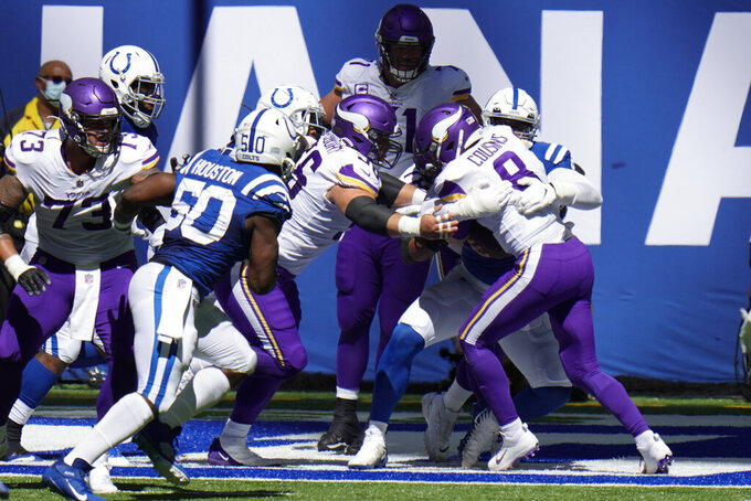 Minnesota Vikings quarterback Kirk Cousins (8) is sacked by Indianapolis Colts' DeForest Buckner (99) for a safety during the first half of an NFL football game, Sunday, Sept. 20, 2020, in Indianapolis. (AP Photo/AJ Mast)