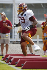 Washington Redskins new offensive lineman Donald Penn (79) runs a drill during NFL football training camp in Richmond, Va., Wednesday, July 31, 2019. Penn was signed Wednesday. (AP Photo/Steve Helber)