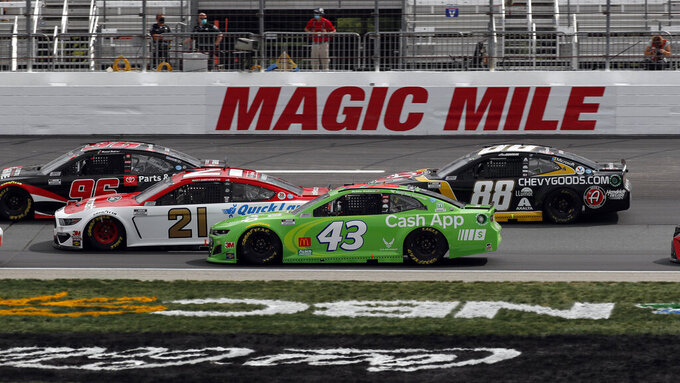 FILE - In this Sunday, Aug. 2, 2020, file photo, drivers, from left, Daniel Suarez (96), Matt DiBenedetto (21), Bubba Wallace (43) and Alex Bowman (88) race in a pack during a NASCAR Cup Series auto race at the New Hampshire Motor Speedway in Loudon, N.H. Corporate interest in Bubba Wallace has picked up momentum and NASCAR's only black full-time driver has signed a new sponsor that includes funding for his Richard Petty Motorports team. Columbia Sportswear signed a multiyear sponsorship with Wallace as a brand ambassador that will also put the company on the No. 43 at Dover later this month.  (AP Photo/Charles Krupa, File)