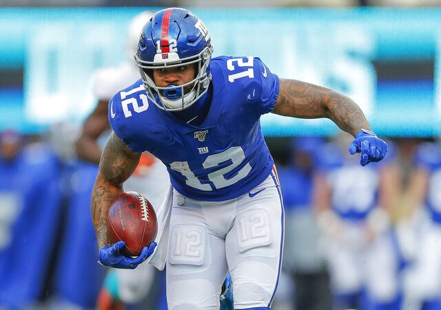 FILE - In this Dec. 15, 2019, file photo, then New York Giants wide receiver Cody Latimer (12) runs in the second half of an NFL football game in East Rutherford, N.J. Washington receiver Cody Latimer, Seattle Seahawks cornerback Quinton Dunbar and New York Giants cornerback DeAndre Baker have been put on the NFL's Commissioner Exempt List while facing felony charges from offseason incidents.   (AP Photo/Adam Hunger, File)