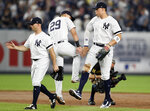 New York Yankees left fielder Brett Gardner, third baseman Gio Urshela (29) and right fielder Aaron Judge, right, celebrate after the Yankees'4-3 victory over the Toronto Blue Jays in a baseball game Tuesday, June 25, 2019, in New York. (AP Photo/Kathy Willens)