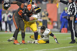 Cleveland Browns defensive end Myles Garrett, left, is grabbed by Pittsburgh Steelers offensive guard David DeCastro (66) after Garrett pulled the helmet off Pittsburgh Steelers quarterback Mason Rudolph (2) in the fourth quarter of an NFL football game, Thursday, Nov. 14, 2019, in Cleveland. The Browns won 21-7. (AP Photo/David Richard)