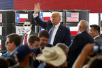President Donald Trump waves to supporters after delivering remarks about American energy production during a visit to the Double Eagle Energy Oil Rig, Wednesday, July 29, 2020, in Midland, Texas. (AP Photo/Tony Gutierrez)