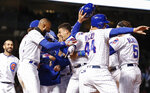 Chicago Cubs' Javier Baez, center, celebrates with teammates after hitting a game winning RBI-single against the Philadelphia Phillies during the ninth inning of a baseball game, Tuesday, May 21, 2019, in Chicago. (AP Photo/Kamil Krzaczynski)
