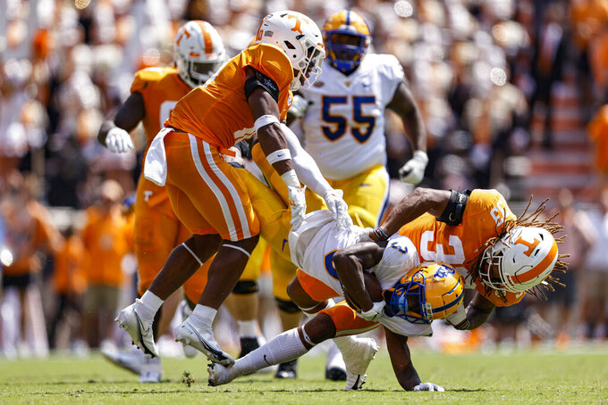 Tennessee linebacker Jeremy Banks (33) tackles Pittsburgh wide receiver Jordan Addison (3) during the first half of an NCAA college football game Saturday, Sept. 11, 2021, in Knoxville, Tenn. (AP Photo/Wade Payne)