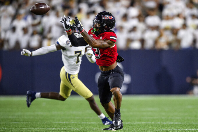 Northern Illinois wide receiver Tyrice Richie (3) catches a pass during the second half of the team's NCAA college football game against Georgia Tech on Saturday, Sept. 4, 2021, in Atlanta. (AP Photo/Danny Karnik)