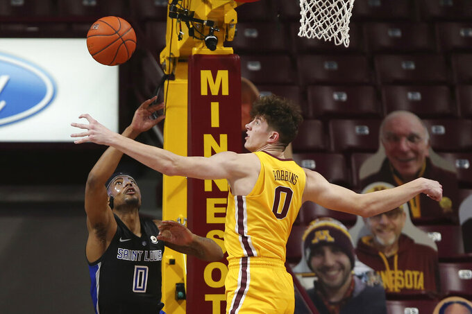 Minnesota's Liam Robbins (0) knocked the ball away from Saint Louis's Jordan Goodwin (0) during an NCAA college basketball game Sunday, Dec. 20, 2020, in Minneapolis. (AP Photo/Stacy Bengs)