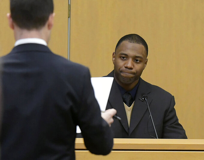 Prosecuting attorney Spencer Walsh, left, asks a question to former NCAA college football player Torrey Green during Green's rape trial, Tuesday, Jan. 15, 2019, in Brigham City, Utah. Green is accused of raping multiple women while he was a football player at Utah State. (Eli Lucero/The Herald Journal via AP)