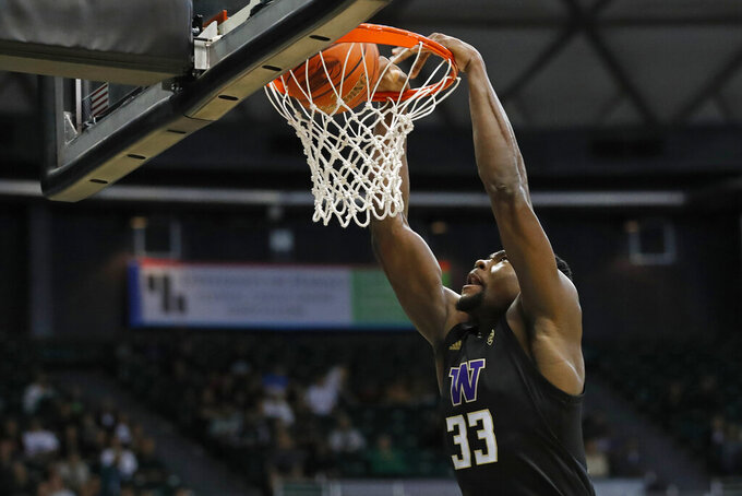 Washington forward Isaiah Stewart dunks during the second half of the team's NCAA college basketball game against Hawaii on Monday, Dec. 23, 2019, in Honolulu. (AP Photo/Marco Garcia)