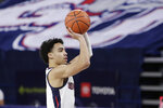 Gonzaga guard Andrew Nembhard shoots during the first half of an NCAA college basketball game against San Francisco in Spokane, Wash., Saturday, Jan. 2, 2021. (AP Photo/Young Kwak)