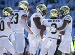 Wake Forest's Kenneth Walker III (9) celebrates with his teammates after scoring a touchdown in the first quarter to give Wake Forest a 7-0 lead over North Carolina at Kenan Stadium on Saturday, November 14, 2020 in Chapel Hill, N.C.(Robert Willett/The News & Observer via AP)