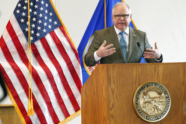 FILE - In this Wednesday, March 18, 2020 file photo, Gov. Tim Walz speaks during news conference in St. Paul, Minn., where he gave an update on the state's effort to slow down the coronavirus. On Friday, April 3, 2020, Walz said he's worried about neighboring states that have yet to issue stay-at-home orders to try and slow the spread of COVID-19. (AP Photo/Jim Mone)